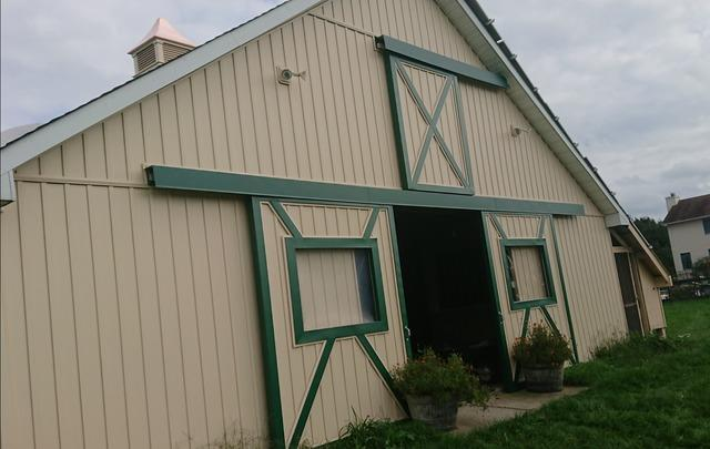 Replacing Wood Siding on Barn with Vinyl with an Adobe Cream Finish and Green PVC Trim in Allentown, NJ