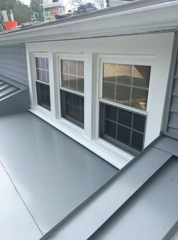 Replacing Asphalt Roof Around Windows with Smooth Dove Grey Standing Seam Metal in Tabernacle, NJ