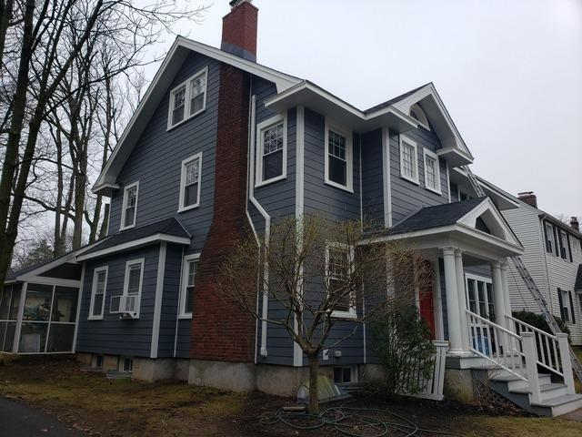 Replacing Old Wood Clapboard Siding with Iron Grey Hardie Smooth Planks in Montclair, NJ