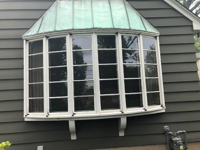Installing Marvin Infinity Casement Windows with White Exterior and Cottage Grids on Metuchen, NJ Home