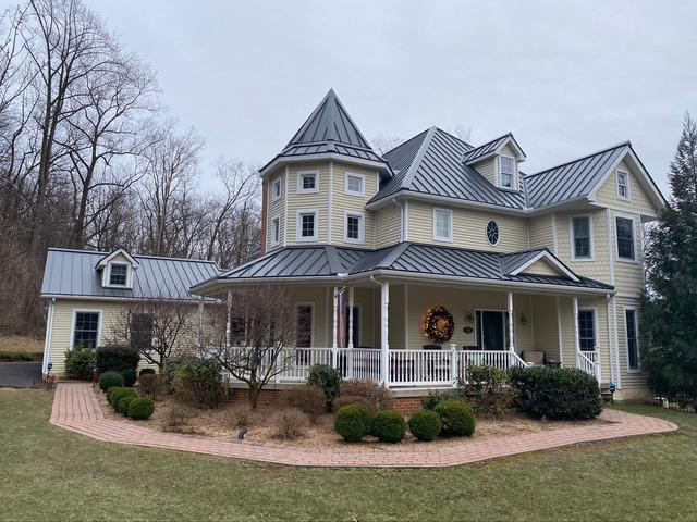 Installing Granite Standing Seam Metal Roof Over Existing Asphalt Shingles on Perkiomenville, PA Home