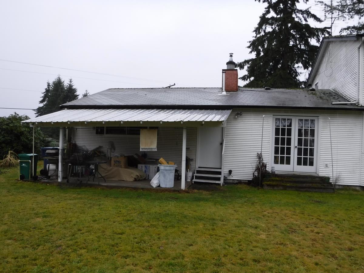 New Roof and Mobile Gutter System Installed in Auburn, WA - Before Photo