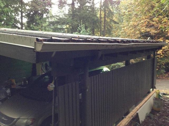 Gutters and Gutter Guards Installed on Metal Roof in Portland, OR - Before Photo