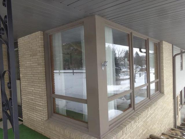 Corner Window Replacement in Austin, MN - Before Photo
