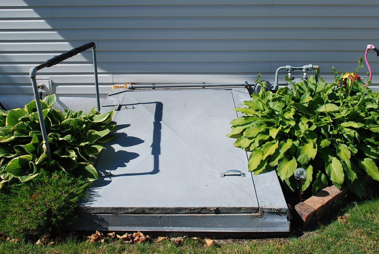 Customer replaced their old Angle Cellar Door in Iowa! - Before Photo