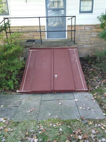 Installation of Flat Cellar Door with Foundation Plates in Ambler, PA