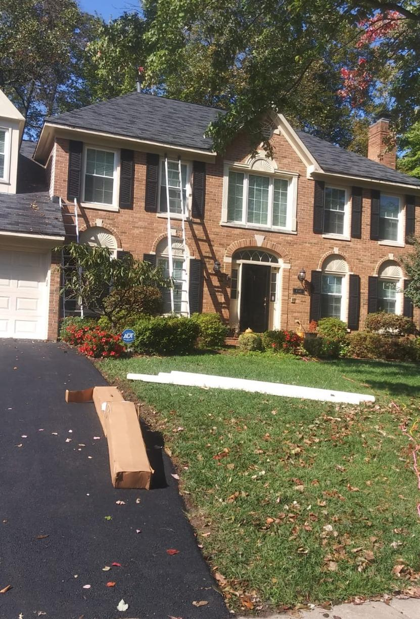 Gutter cleaning nightmare in Fairfax Station, VA - Before Photo