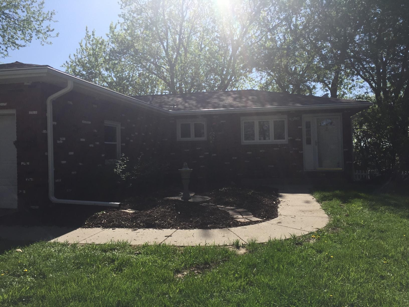Clogged Gutters Replaced on Brick Home in Glenwood, IA - After Photo