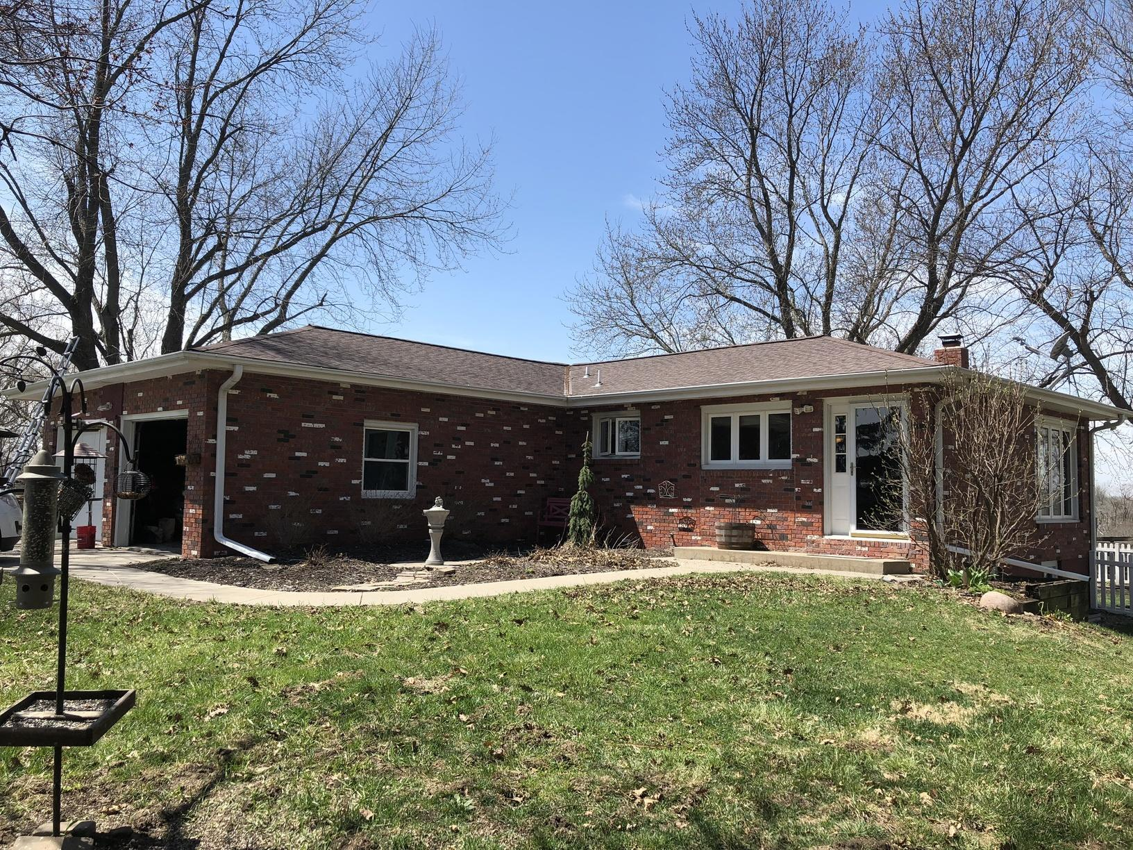 Clogged Gutters Replaced on Brick Home in Glenwood, IA - Before Photo