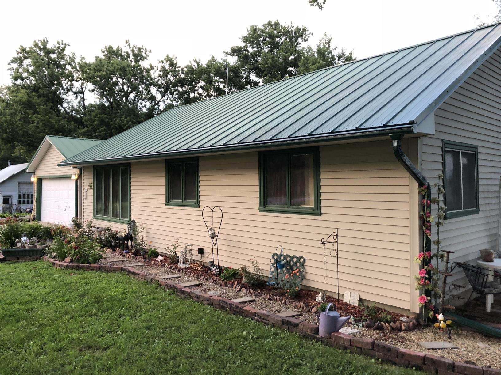 Gutters Installed on Home with a Metal Roof in Tabor, IA - After Photo