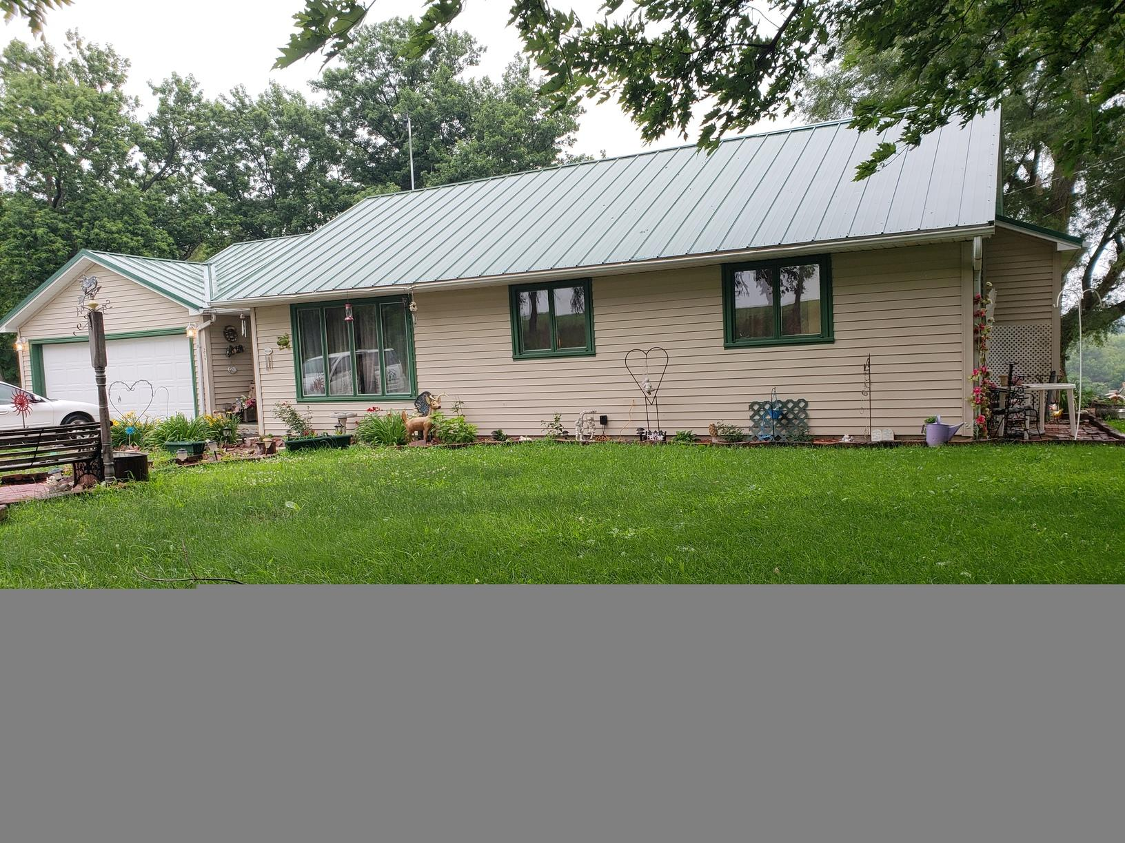Gutters Installed on Home with a Metal Roof in Tabor, IA - Before Photo