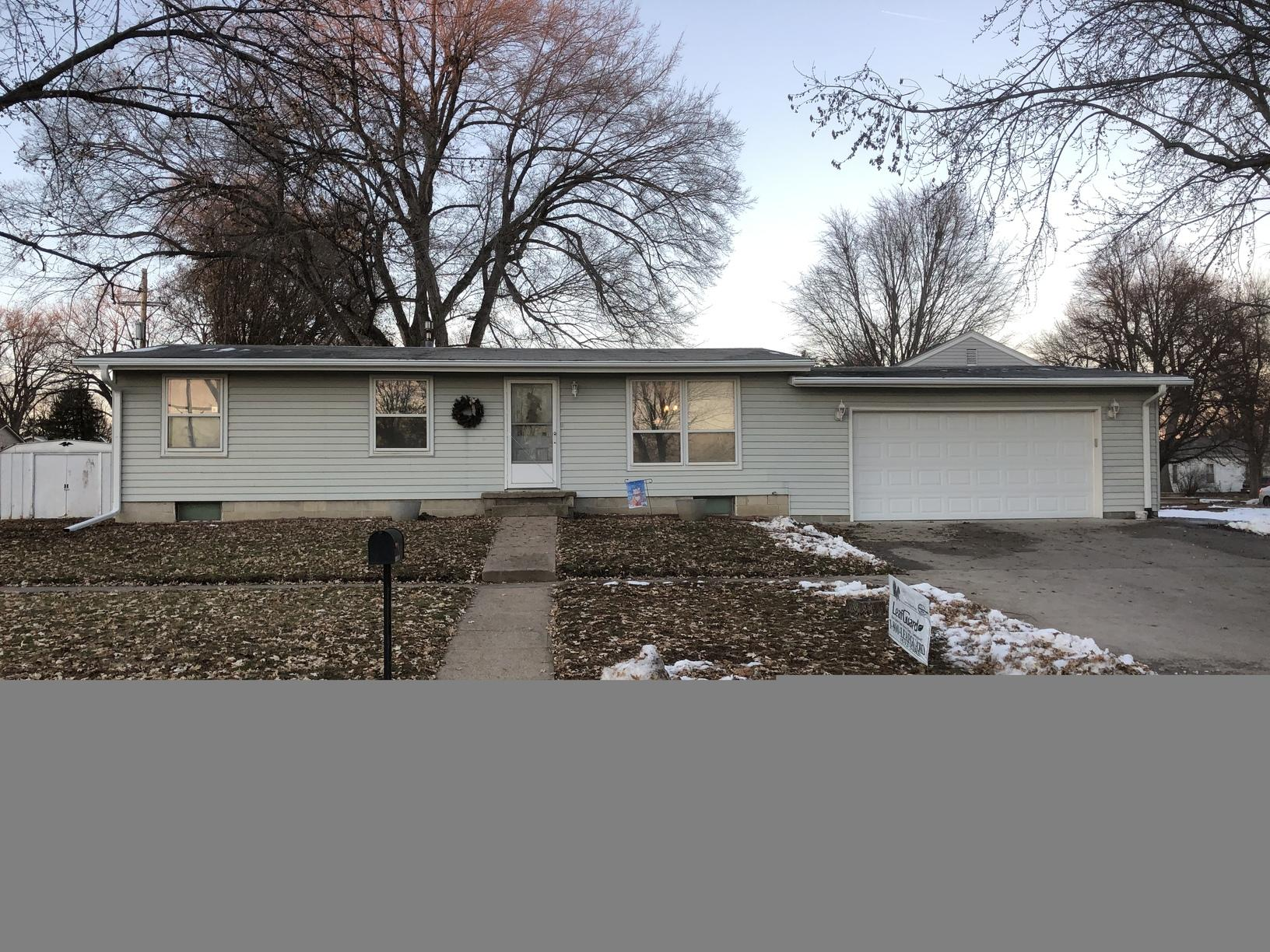 White LeafGuard Gutter Installation in Auburn, NE - After Photo