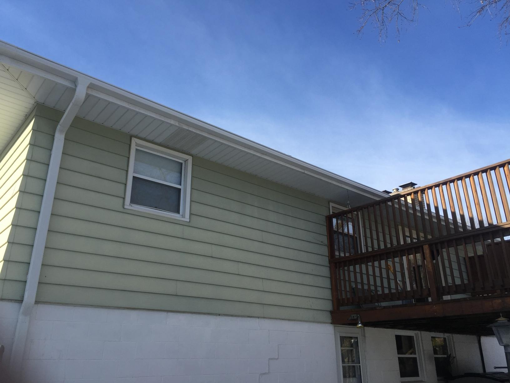 White LeafGuard Gutters Installed on home in Bellevue, NE - After Photo