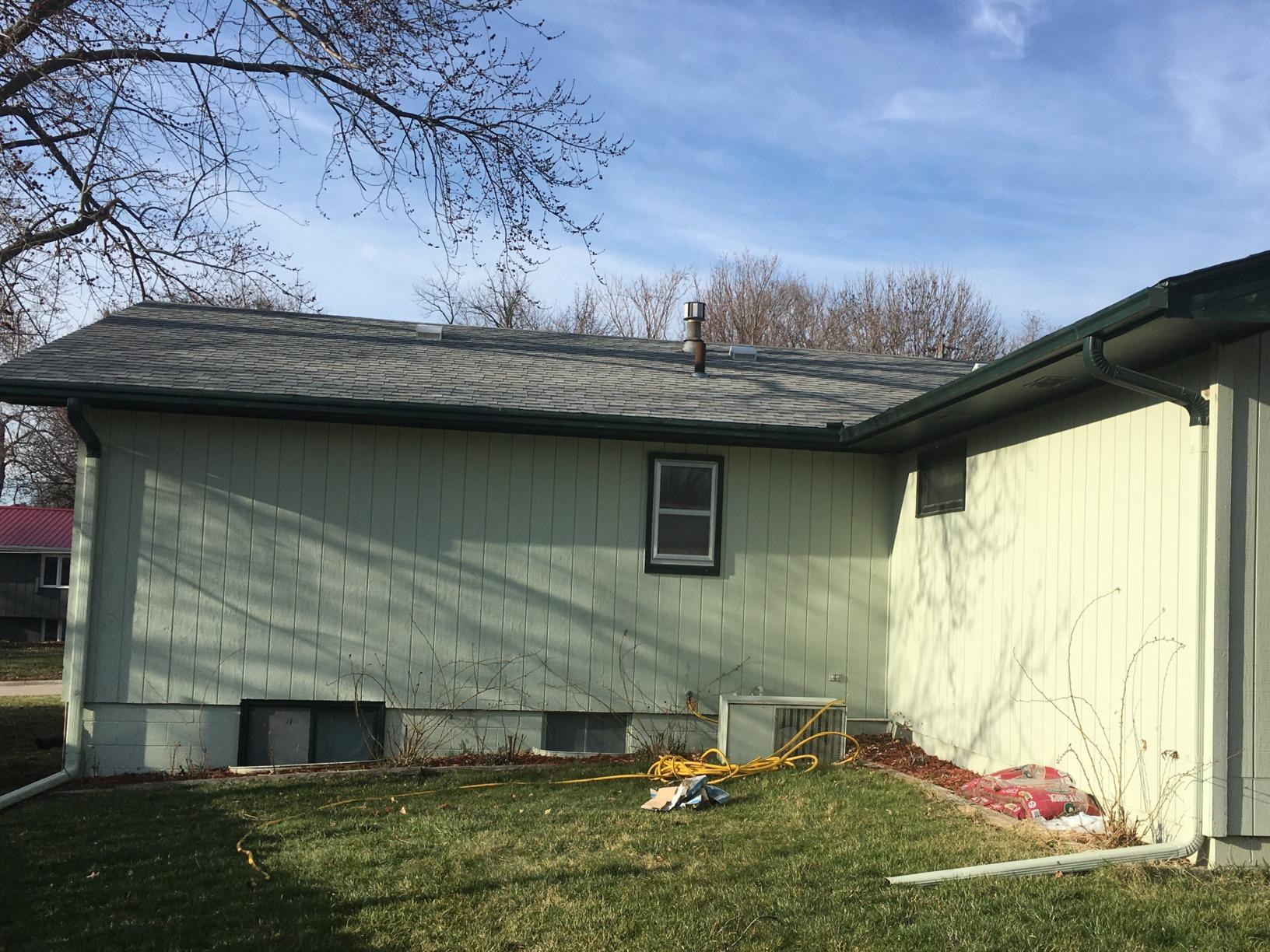 White LeafGuard Gutters Installed on back of home in Shenandoah, IA - Before Photo