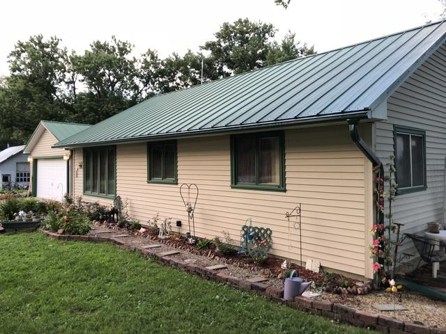 Gutters Installed on Home with a Metal Roof in Tabor, IA