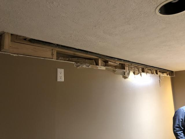 Two-Part Foam Install After Water Pipe Burst in Basement Wall of Home in Omaha, NE - Before Photo