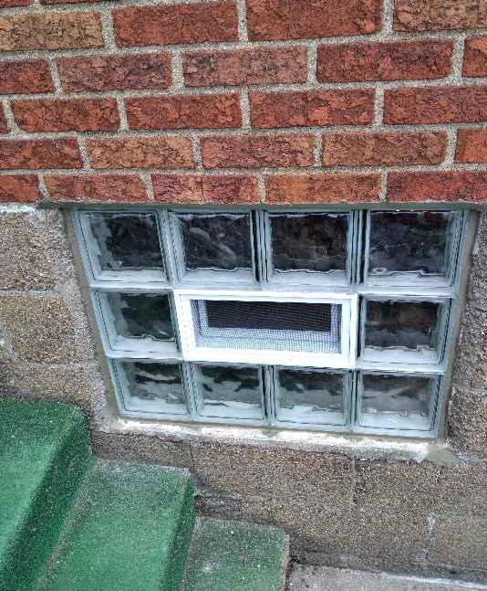 Removal and Disposal of Existing Windows and Installation Wave with Air Vent - After Photo