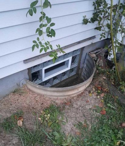 Basement Wave Glass Block windows installation with a vent in Homestead, PA