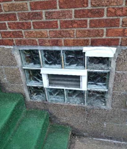 Removal and Disposal of Existing Windows and Installation Wave with Air Vent - Before Photo