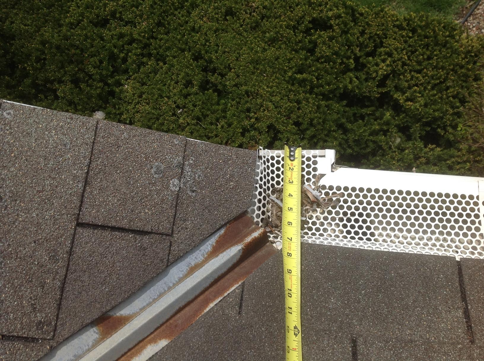 New GAF Timberline Roof and LeafGuard Gutters Installed on home in Allouez, WI - Before Photo