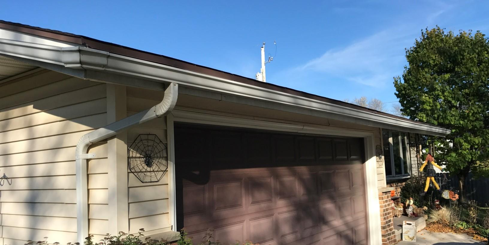 Replacing Open Style Gutters with LeafGuard in Sheboygan, WI - Before Photo