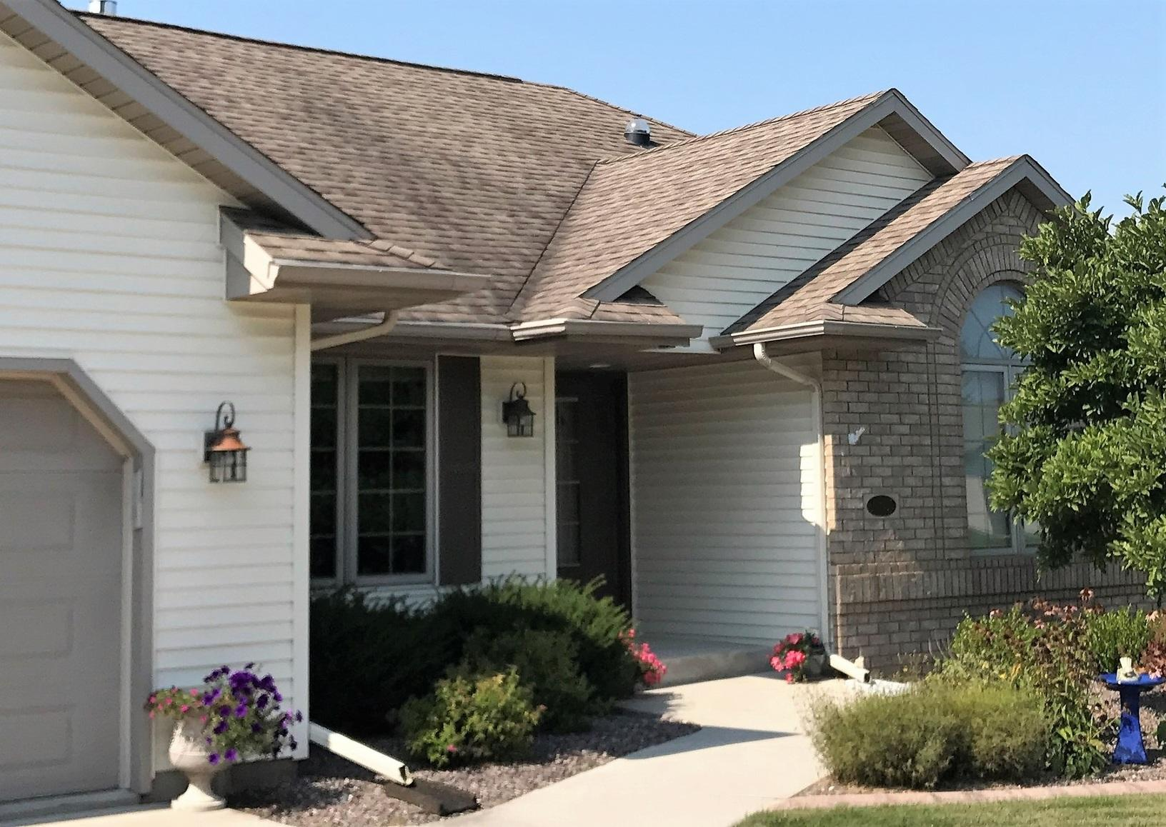 Two Tone LeafGuard a Great Look for this Home in Sheboygan Falls, WI - Before Photo