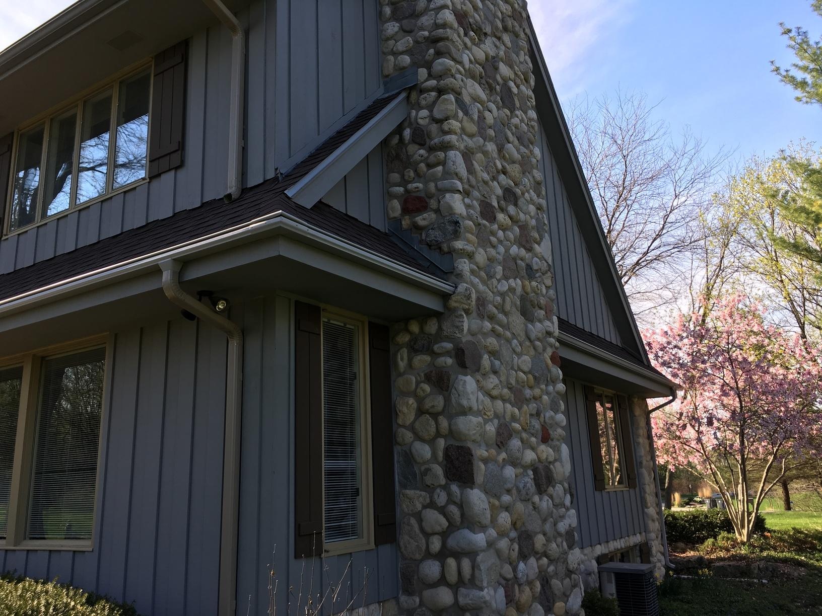 Grey LeafGuard Gutters Installed on a Home in Sheboygan, WI - After Photo