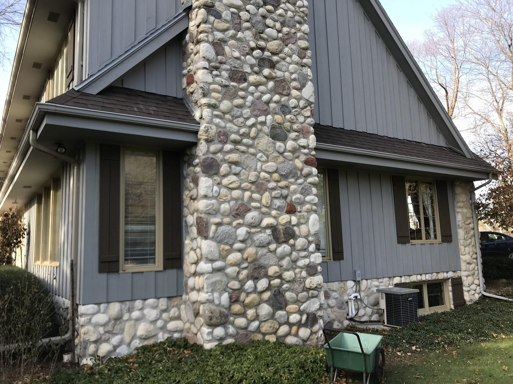 Grey LeafGuard Gutters Installed on a Home in Sheboygan, WI - Before Photo