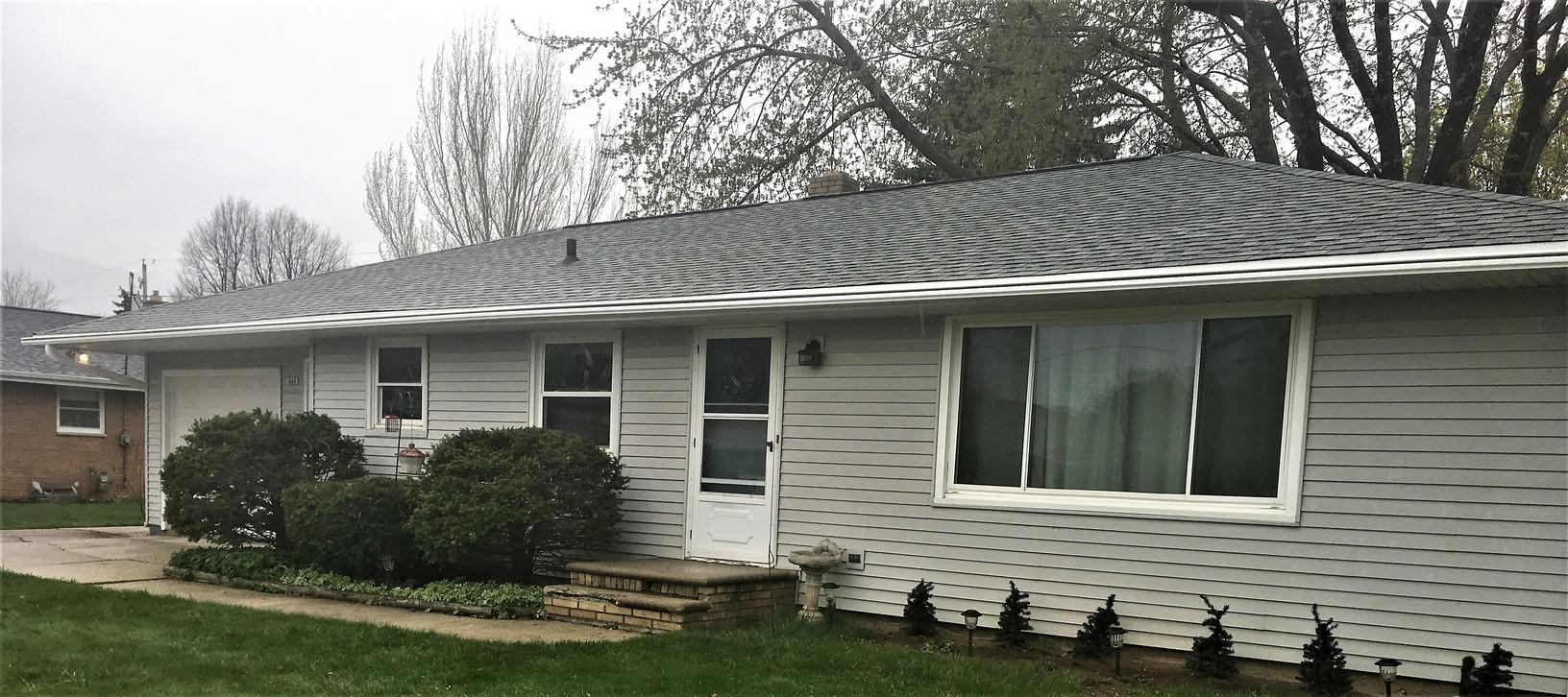 Homeowner in Green Bay Chooses Keeney Home Services for both GAF Roof and LeafGuard Gutters - After Photo