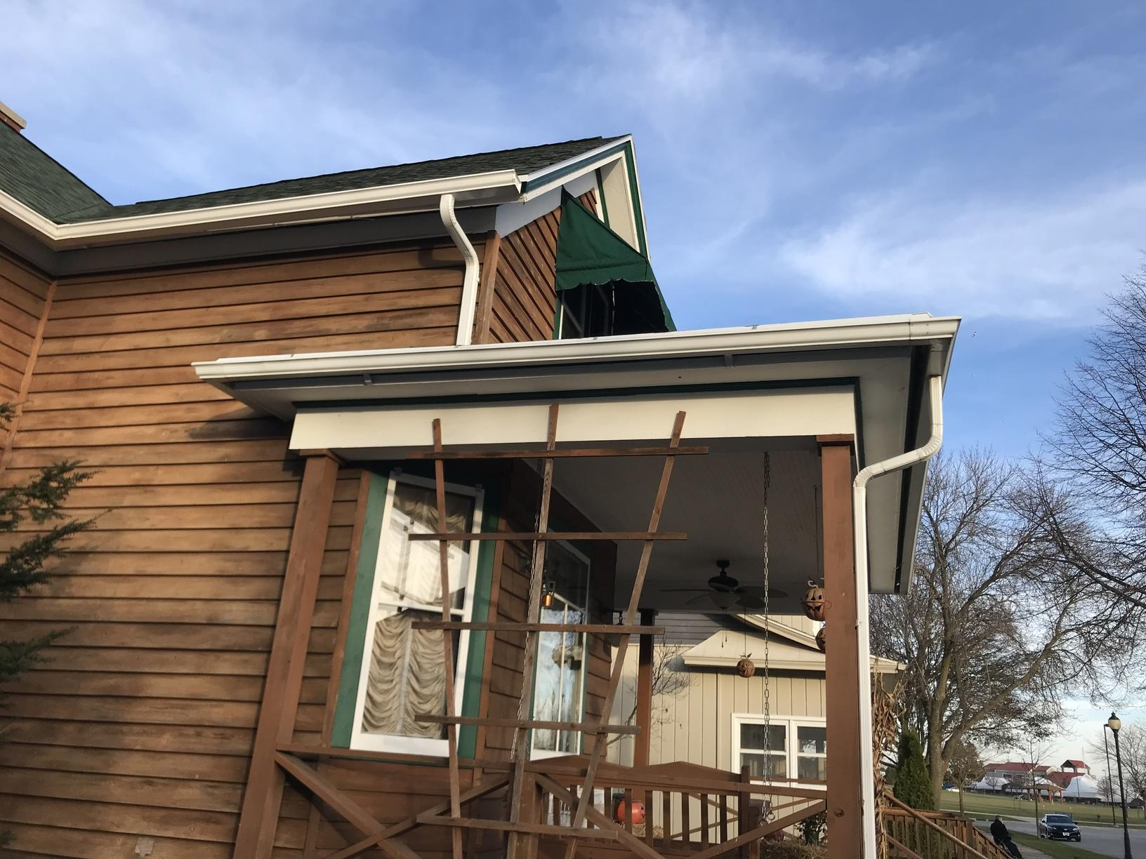 Dark Green LeafGuard Gutters Installed on a Home in Sheboygan, WI - Before Photo