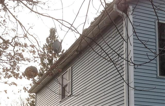 Replacing Clogged Gutters in Waupaca