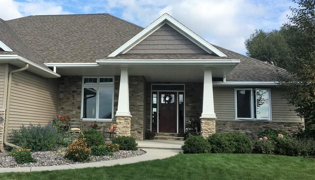 LeafGuard White Gutters with Clay Downspouts Installed in Depere, WI