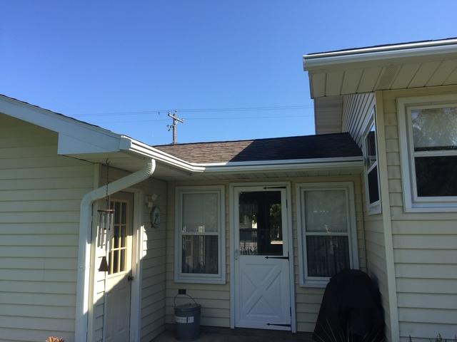 White LeafGuard Gutters Installed in Marinette, WI