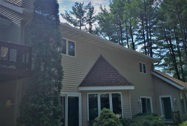 LeafGuard Gutters Installed on a Home Surrounded by Pine Trees in Waupaca, WI