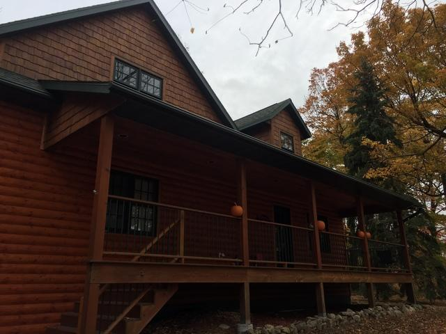 Hartford Green LeafGuard Gutters Installed on a Log Home in Brussels, WI