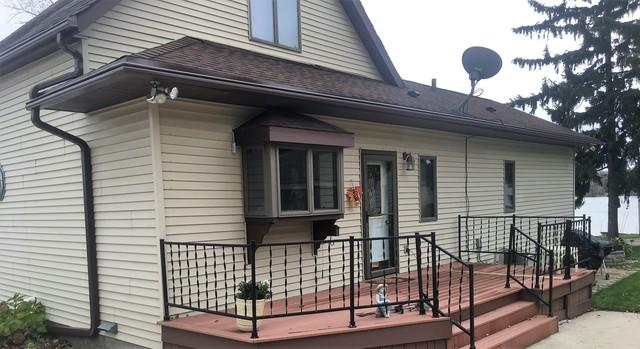 LeafGuard Gutters - color Brown, Installed on a Home in Random Lake, WI