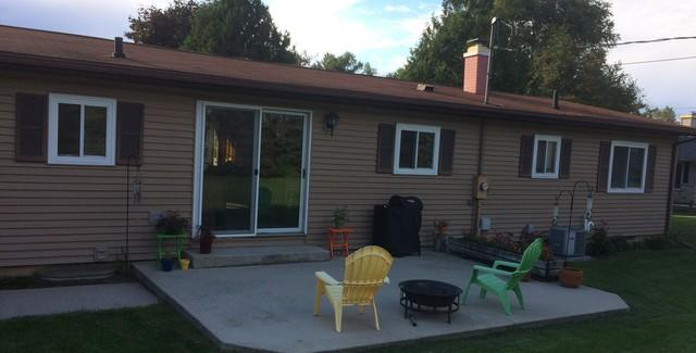 Newly Installed GAF Asphalt Roof and LeafGuard Gutters on a Ranch in Sturgeon Bay, WI