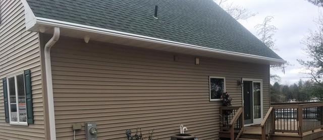 Tan LeafGuard Gutters Installed on a Cottage in Crivitz, WI