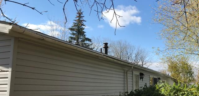 Replacing Open Style Gutters with LeafGuard in Shiocton, WI