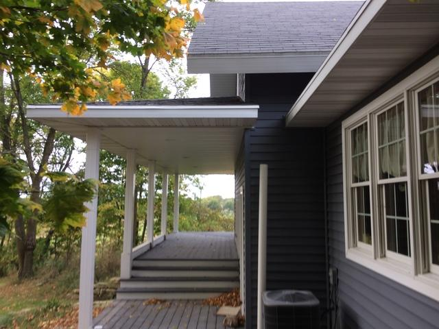 Installing White LeafGuard Gutters on a Country Home in Brussels, WI