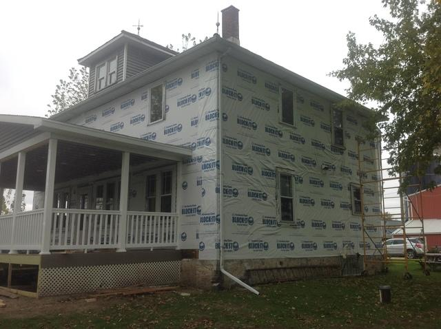 White LeafGuard Gutters Installed on a Two Story Home in Chilton, WI