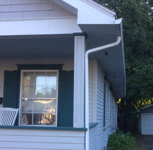 Installing White LeafGuard Gutters on a Bungalow in Sturgeon Bay, WI