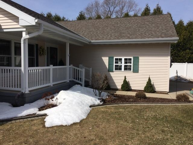 White LeafGuard Gutters Installed on a Home in Sturgeon Bay, WI