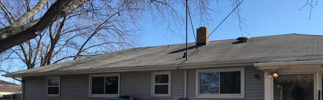 Homeowner in Green Bay Chooses Keeney Home Services for both GAF Roof and LeafGuard Gutters