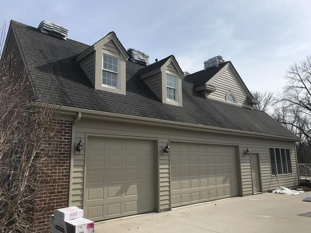 GAF Asphalt Shingle Roof and LeafGuard Gutters Chosen by Homeowner in Sheboygan, WI - Before Photo