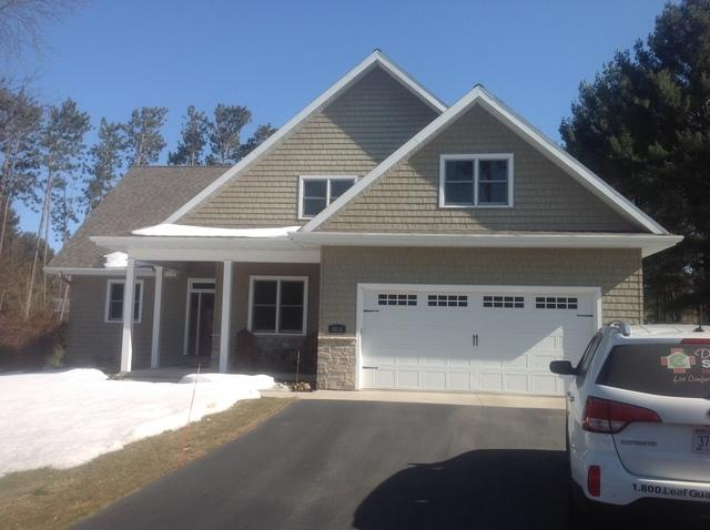 LeafGuard Installed Using White Gutters and Tan Downspouts on a Home in Wausau, WI