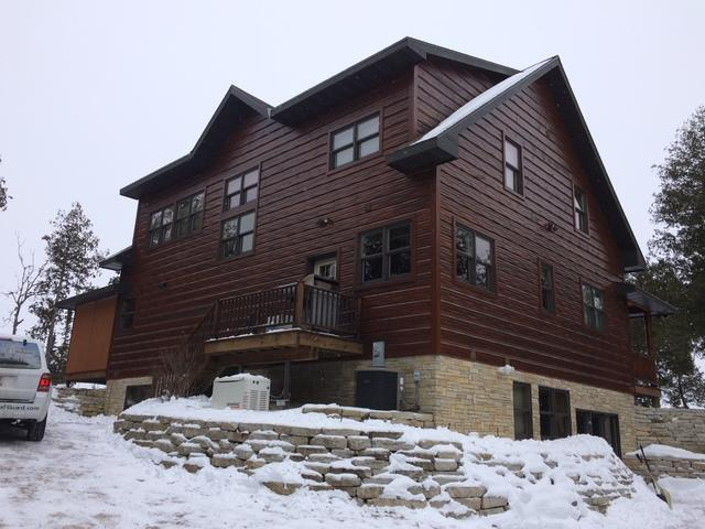 Musket Brown LeafGuard Gutters Installed on a Two Story Home in Ellison Bay, WI