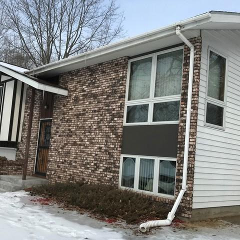 No Clog LeafGuard Gutters Installed on a Home in Hatley, WI