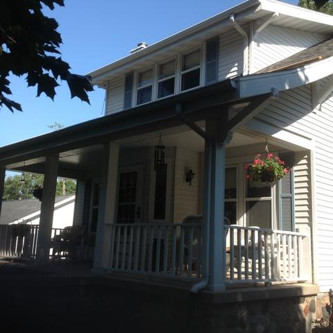 White LeafGuard Gutters Installed on a Bungalow in Neenah, WI