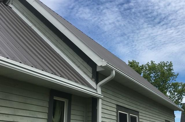 LeafGuard Gutters Installed on a Home with a Metal Roof in DePere